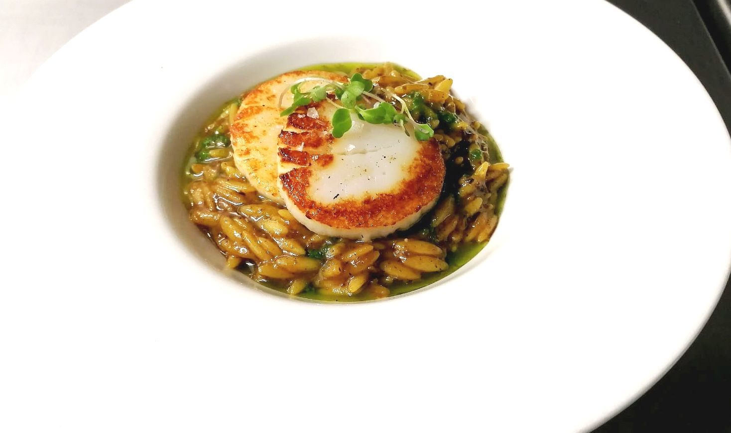 Fals risotto of mushrooms and flame roasted scallop
